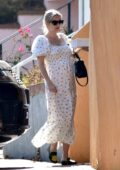 Emma Roberts looks lovely in a white summer dress while visiting a friend with sweet treats in Los Angeles