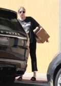 Emma Roberts seen wearing an oversized Harley-Davidson tee while picking up breakfast from Alfred's in Los Angeles