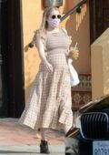Emma Roberts shows her growing baby bump in a beige checkered dress as she steps out in Los Angeles
