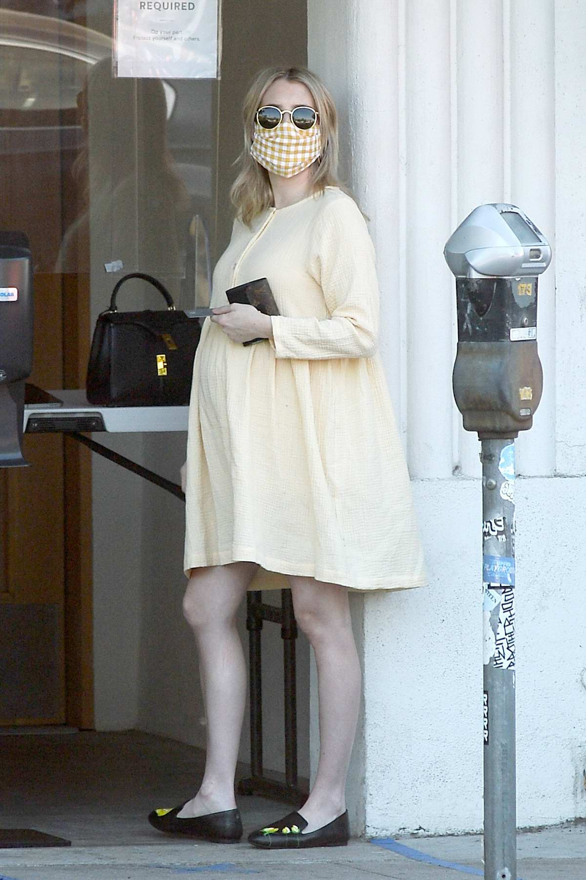 Emma Roberts shows her growing baby bump while heading out to a coffee shop in Los Angeles