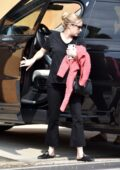 Emma Roberts spotted in all-black as she returns to her home with a friend after running errands in Los Angeles