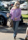 Emma Roberts wears a purple shirt and jeans while running a few errands in Los Angeles