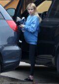 Emma Roberts wears an oversized sweatshirt and leggings while arriving home in Los Feliz, California
