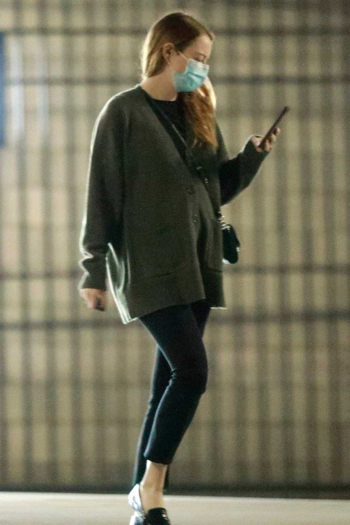 Emma Stone looks cozy in an oversized cardigan as she heads to a meeting in Santa Monica, California