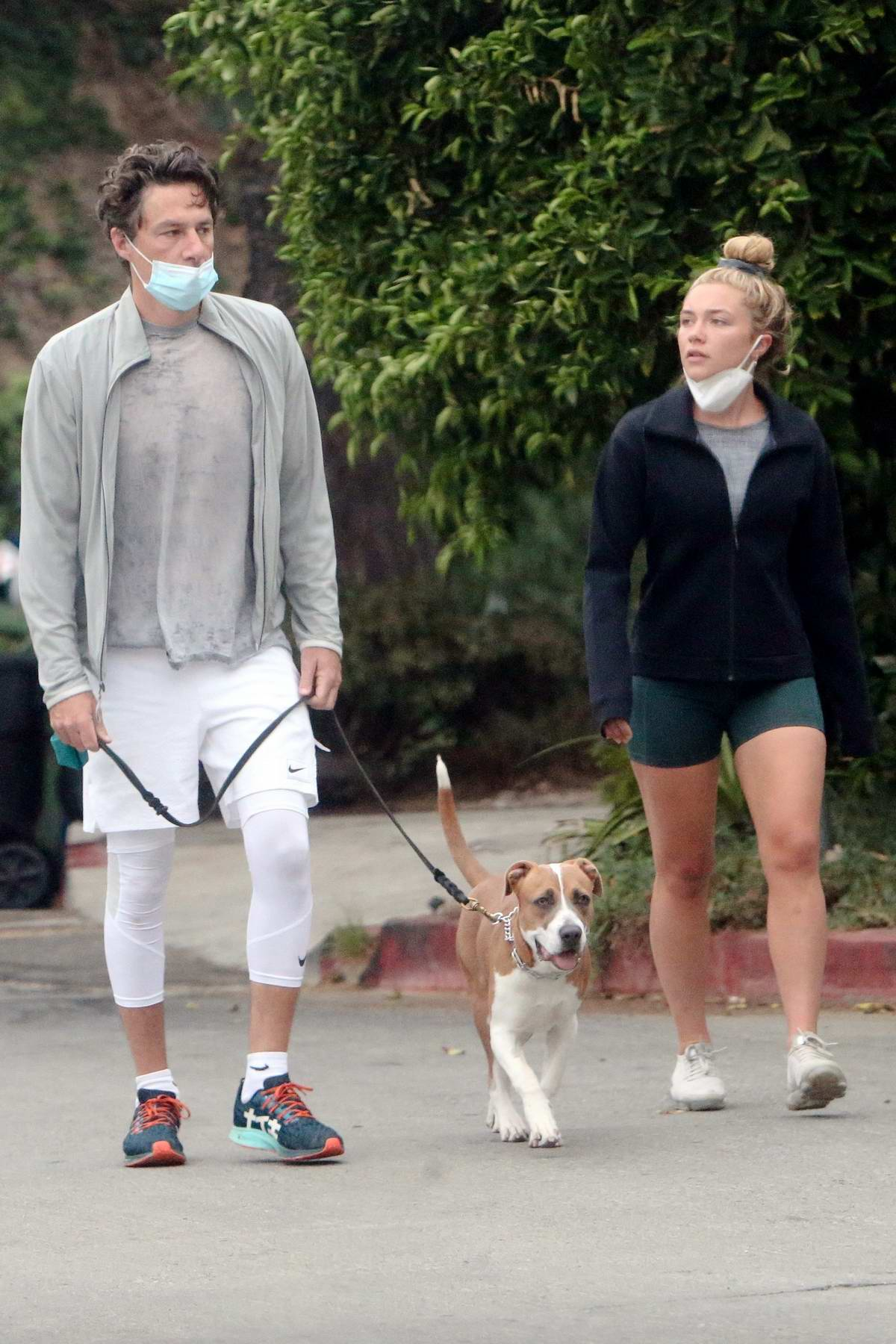 Florence Pugh takes an early walk with boyfriend Zach Braff and their dog around their neighborhood in Los Angeles