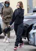 Hailey Bieber arrives at a spa wearing black sweats in Los Angeles