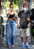 Hailey Bieber flashes her toned abs in a black crop top while out for lunch with Justin Bieber at Il Pastaio in Beverly Hills, California