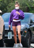 Hailey Bieber flaunts her toned legs in purple Nike shorts with matching crop top while visiting a friend in Los Angeles