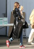 Hailey Bieber rocks a black leather coat as she arrives at a studio with her dog ahead of a photoshoot in Los Angeles