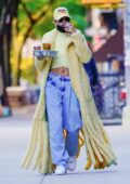 Hailey Bieber shows off her style in a fuzzy yellow coat while out on a coffee run in New York