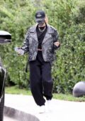 Hailey Bieber sports a trendy look while stopping by a friend's house in Beverly Hills, California