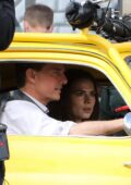 Hayley Atwell and Tom Cruise seen while filming scenes in a yellow Mini Cooper on the set of 'Mission Impossible 7' in Rome, Italy