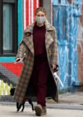 Hilary Duff looks cozy in a warm long coat while out for a stroll with husband Matthew Koma in New York City