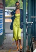 Irina Shayk looks striking in a lime green dress and a black leather jacket while out running errands in New York City
