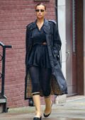 Irina Shayk looks stylish in a Burberry trench coat and Chanel rainy boots during a solo walk in New York City
