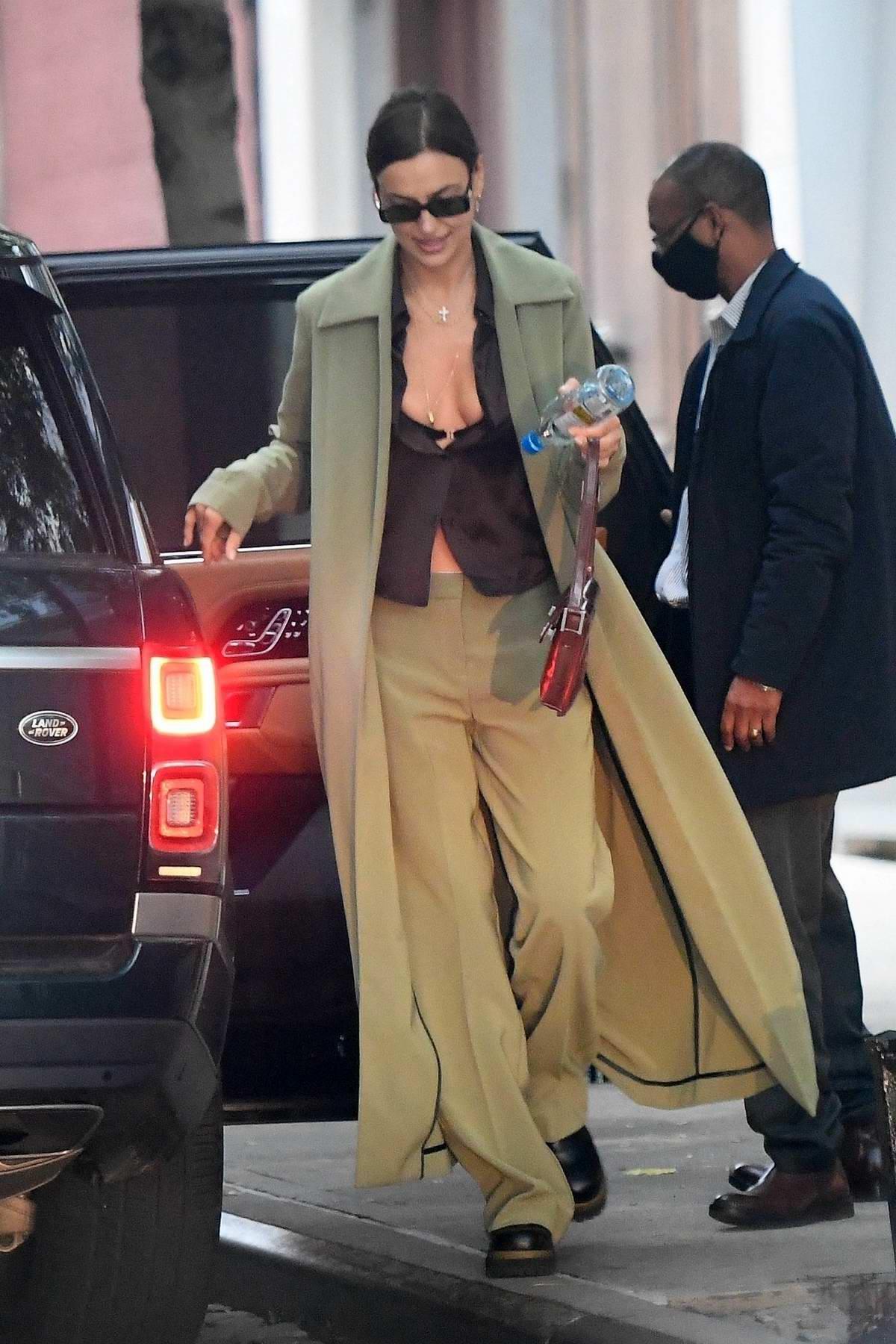Irina Shayk looks stylish while she hops into Vito Schnabel's Range Rover in New York City