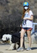 Isla Fisher keeps it casual in shorts and a tee during a hike session with her dog in Los Angeles