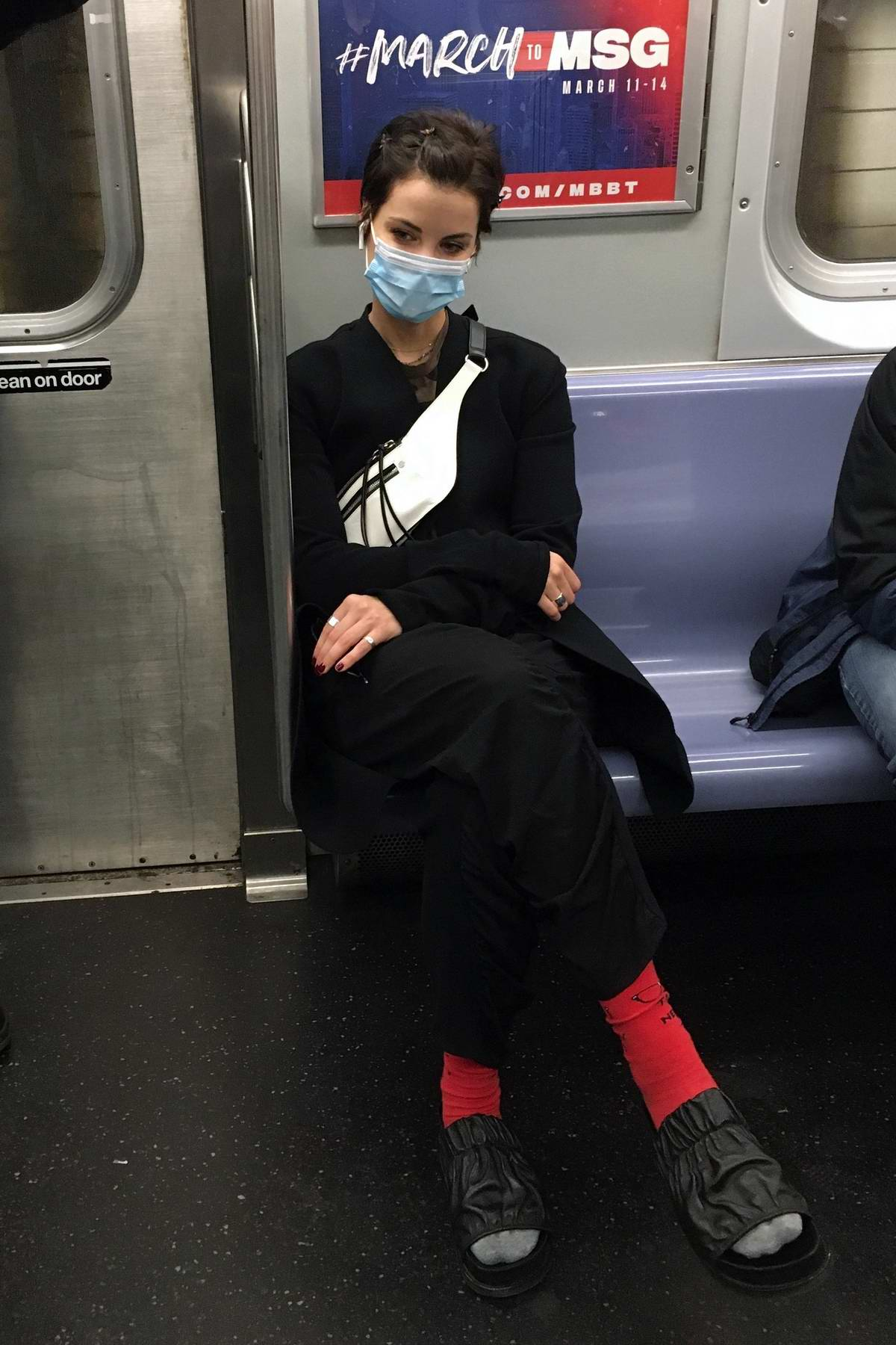 Jaimie Alexander seen wearing a mask while riding the Subway in Downtown Manhattan, New York