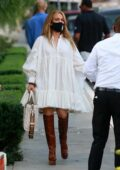 Jennifer Lopez wears a flowing white dress as she leaves San Vicente Bungalows in West Hollywood, California