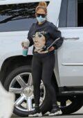 Jennifer Lopez wears Barbara Streisand sweatshirt and black leggings for a business meeting in Beverly Hills, California
