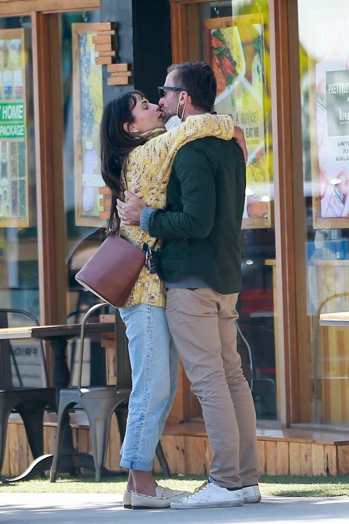 Jordana Brewster and boyfriend Mason Morfit share some PDA while out in Brentwood, California