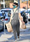 Jordana Brewster wears gray overalls while grabbing some Chipotle in Brentwood, California