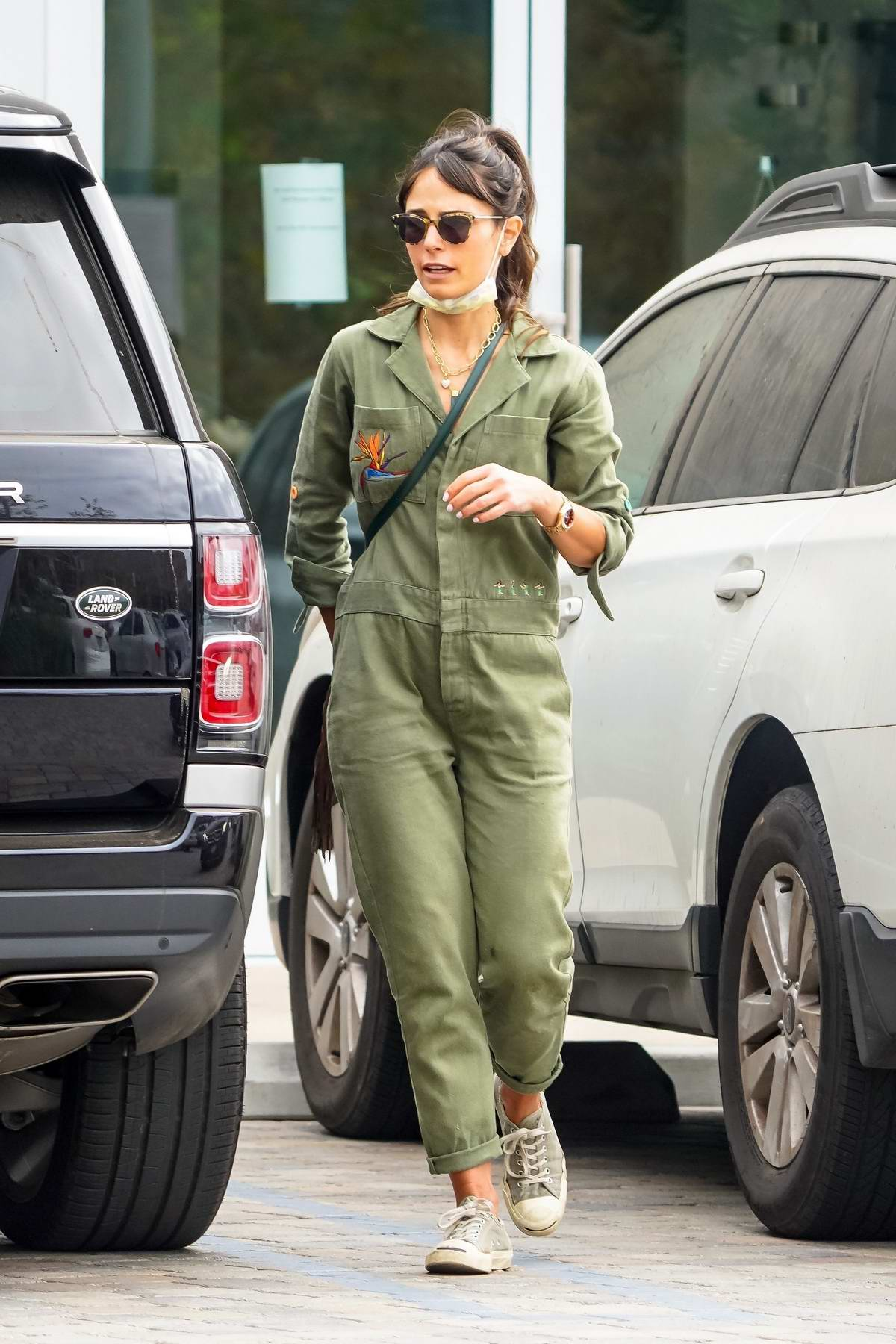 Jordana Brewster wears a green jumpsuit while out for walk with her dog in Malibu, California