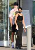 Kaia Gerber and boyfriend Jacob Elordi wait for their lunch order in Malibu, California