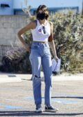 Kaia Gerber steps out to vote with her mom Cindy Crawford and dad Rande Gerber in Malibu, California