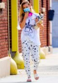 Kaley Cuoco carries her senior rescue dog 'Dumpy' while out on a morning stroll in New York City