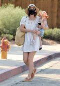 Kate Mara steps out in a white minidress as she takes her daughter to a class in Glendale, California