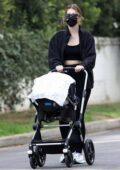 Katherine Schwarzenegger takes her newborn daughter out for a stroll with her mother Maria Shriver in Los Angeles