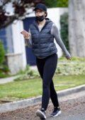 Katherine Schwarzenegger wears a puffy jacket and leggings for her power walk around Santa Monica, California