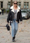 Kelly Brook dons a fur-lined leather jacket and flashes a smile while arriving at Global Radio studios in London, UK