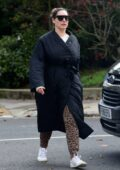 Kelly Brook dresses down in an oversized black puffy coat and animal print sweatpants as she steps out in London, UK
