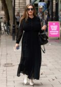 Kelly Brook looks amazing in a black maxi dress as she heads to Global Radio Studios in London, UK