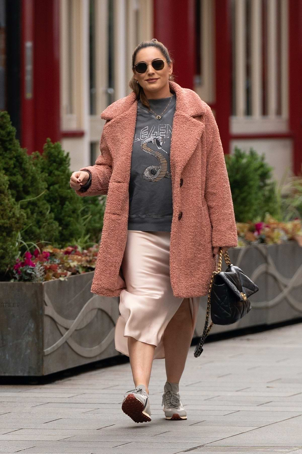 Kelly Brook looks cozy in a teddy coat as she arrives at the Global Radio Studios in London, UK