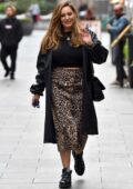 Kelly Brook looks gorgeous in animal print skirt paired with a black top and coat as she heads to Heart Radio in London, UK