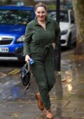 Kelly Brook looks great in a green corduroy jumpsuit as she arrives at the Global Radio Studios in London, UK