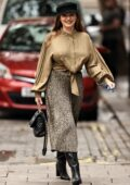 Kelly Brook looks stunning in a satin blouse and animal print pleated skirt while arriving at Global Radio in London, UK