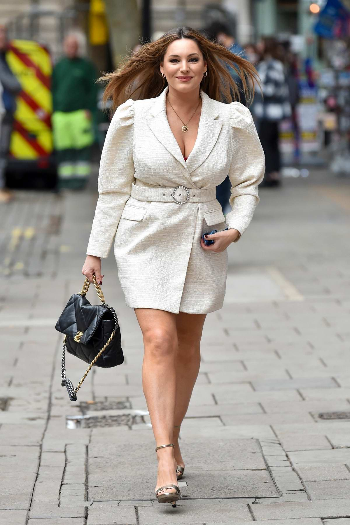 Kelly Brook looks stylish in a cream blazer dress as she arrives at the Global studios in London, UK