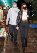 Kendall Jenner and Devin Booker enjoy a night out with friends in West Hollywood, California