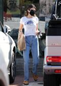 Kendall Jenner looks cute in denim and a crop top tee while she picks up lunch and a fresh juice in Malibu, California