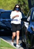 Lea Michele wears a white sweatshirt and black legging shorts while out for stroll in Los Angeles