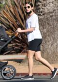 Lea Michele wears white tee and black legging shorts while out for a walk with her newborn baby in Santa Monica, California