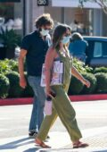 Leighton Meester wears green overalls while out shopping with husband Adam Brody in Santa Monica, California
