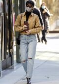 Lili Reinhart wears a brown denim jacket with blue jeans as she steps out for coffee in Vancouver, Canada