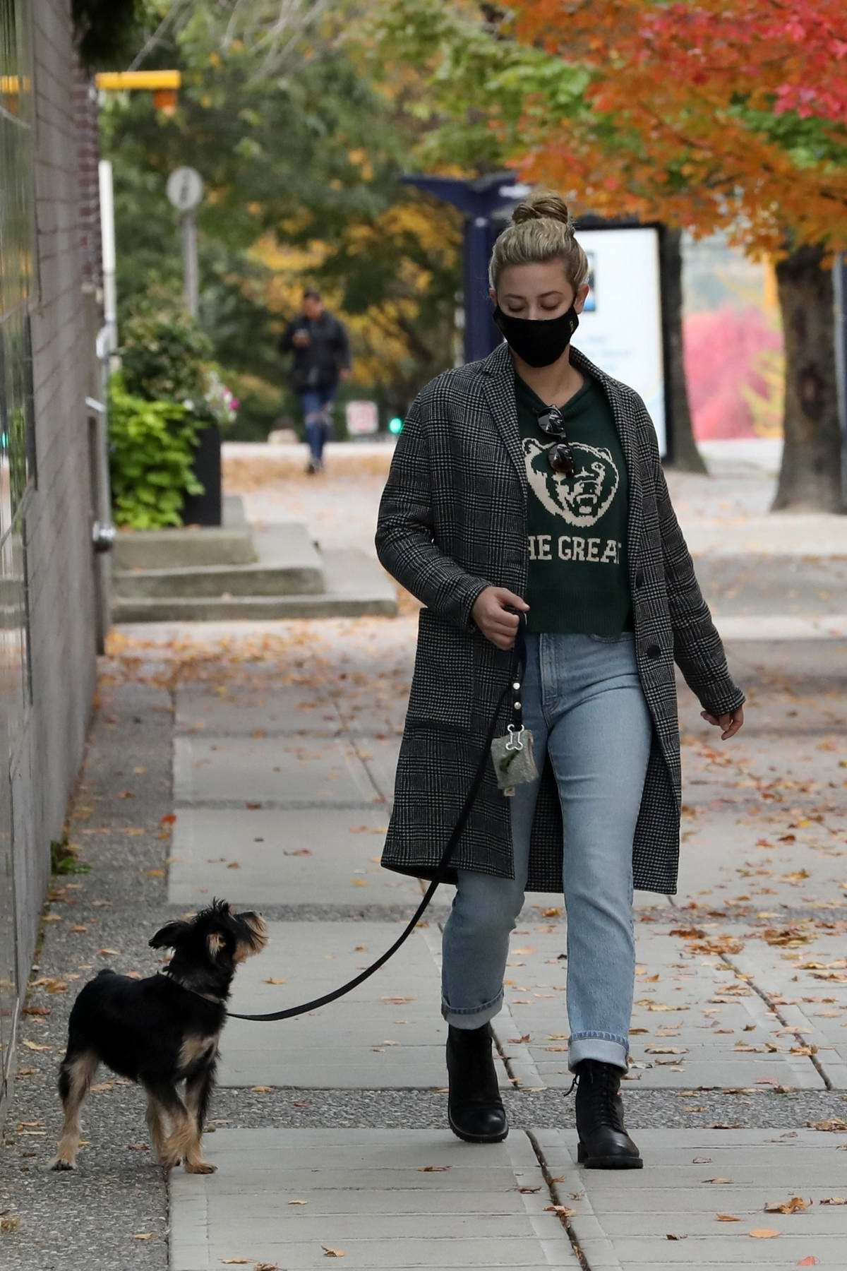 Lili Reinhart wears a warm coat on a fall morning walk with her pooch in Vancouver, Canada