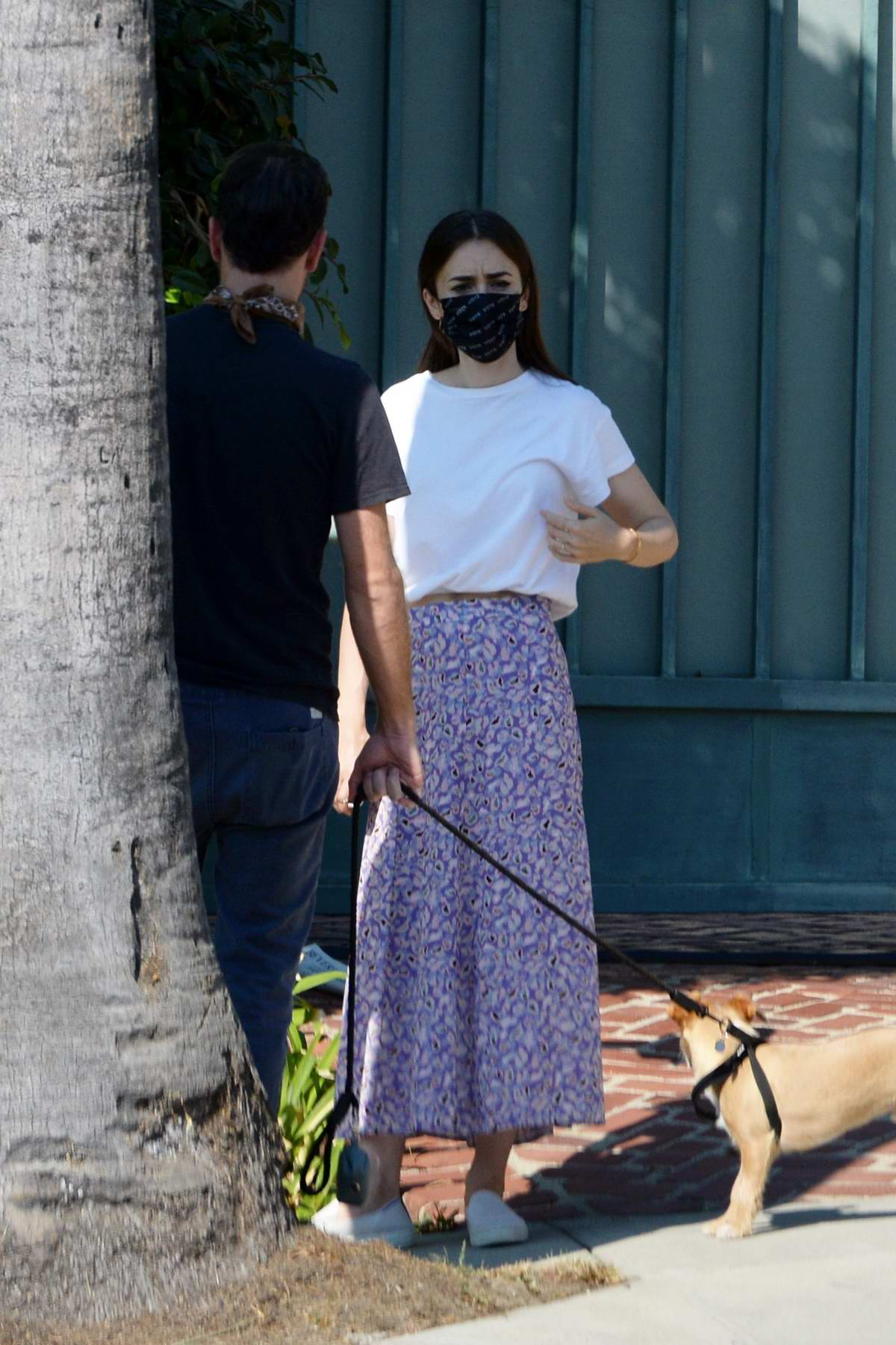 Lily Collins and Charlie McDowell step out for a morning stroll with their dog in Los Angeles