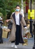 Lily James goes shopping for flowers near her home in Primrose Hill, London, UK